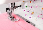 Sewing Process Of Rosy Dress On The Machine