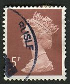 UK-CIRCA 1993: A stamp printed in UK shows image of Elizabeth II is the constitutional monarch of 16