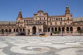SEVILLE, SPAIN - MAY 14: Tourist in a horse carriage visiting the Plaza de Espana on May 14, 2013 in