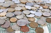 Pile Of Different Coins On Isolated Background Tilt
