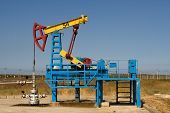 picture of nonrenewable  - An industrial oil pump under a blue sky - JPG