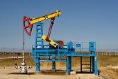 image of nonrenewable  - An industrial oil pump under a blue sky - JPG