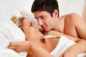 image of intercourse  - couple has fun in bed - JPG