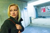 picture of underpass  - a young woman in an underpass for pedestrians is afraid of harassment and crime - JPG