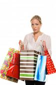 a woman with colorful shopping bags while shopping. scares about their purchases.