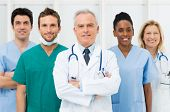 stock photo of nurse uniform  - Smiling team of doctors and nurses at hospital - JPG