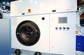 foto of oversize load  - Large white modern industrial washing machine at special presentation - JPG
