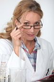 Woman wearing a lab coat
