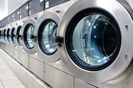 image of washing machine  - A row of industrial washing machines in a public laundromat - JPG