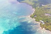 foto of land-mass  - aerial view of the barrier reef of the coast of San Pedro Belize - JPG