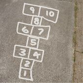 Hopscotch Game In Chalk On Sidewalk