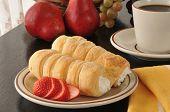 stock photo of cream puff  - Cream horns or cream puffs with sliced strawberries - JPG
