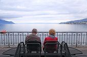 Senior Man And Woman Relaxing At Lake Geneva, Switzerland