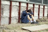 foto of depressed teen  - Teens problems teenager alone at the city - JPG