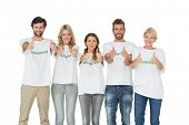Group portrait of happy volunteers gesturing thumbs up over white background