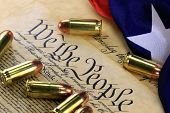 foto of bill-of-rights  - US Constitution Bill of Rights with 45 caliber bullets and American flag - JPG