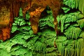 Strange green-lit stalagmite shapes in Soreq Cave Israel