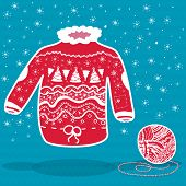 Red Knitted Christmas Sweater And A Ball Of Yarn