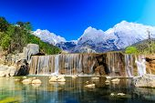image of jade  - A view of a river and Jade Dragon Snow Mountain in Lijiang  - JPG