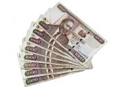 image of shilling  - an arrangement of kenyan paper currency thousand shilling notes - JPG