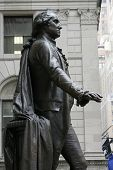 NEW YORK - DEC 19: A profile view of a statue of George Washington is shown in front of Federal Hall
