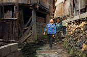 Asian Rural, Peasant, Farmer, Kids Teens Walk Around Chinese Village.