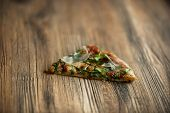 Slice Of Pizza Rucola, Basil, Dried Tomatoes And Cheese
