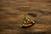 Delicious Italian Pizza Slice On Wooden Table