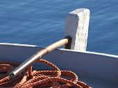 foto of rudder  - rudder and ropes on old wooden boat - JPG