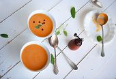 Bowl Of Soup With Pumpkin On White Wooden Table Healthy Diet