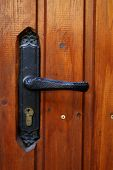 locking handle on the front wooden door