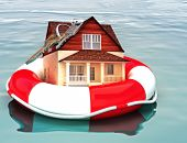 stock photo of flood  - Home floating on a life preserver - JPG
