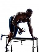 one muscular handicapped man body builders building weights with legs prosthesis in silhouette on wh