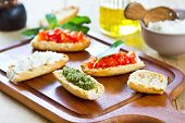 Crostini With Pesto, Cheese,and Tomato