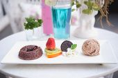 Chocolate Fondant Cake With Fruit And Ice-cream