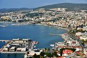 KUSADASI, TURKEY - APRIL 7, 2014: Aerial view to the bay and cityscape. Many cruise liners visit Kusadasi Port and most of cruise guests are interested in seeing Ephesus Ancient City