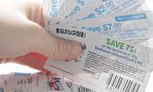 Coquitlam, BC, Canada - May 25, 2014 : Close up holding saving coupons. All coupons for Canadian sto
