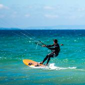 young handsome  Kite Surfer in sea waves