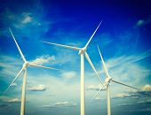 Vintage retro effect filtered hipster style image of green renewable energy concept - wind generator