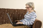 Happy Senior Woman Using Laptop