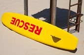 Small Yellow Rescue Boat Lays On The Beach