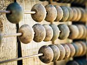 stock photo of subtraction  - a old wooden abacus as a background - JPG