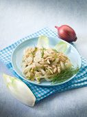 stock photo of sauteed  - salad with sauteed endive onions and pine nuts - JPG
