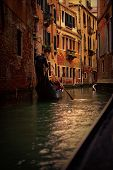 stock photo of gondolier  - View of gondola with gondolier at narrow street of city - JPG