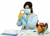 Expert Viewing Closely A Yellow Bell Paper In Laboratory