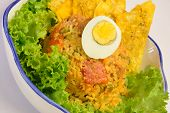 Colombian cuisine. Rice with sausage, eggs and fried patacon.