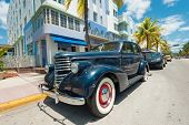 MIAMI,USA - MAY 21,2014 : Vintage car parked at Ocean Drive in Miami Beach, Florida. Art Deco architecture in South Beach is one of the main tourist attractions in Miami