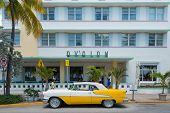 MIAMI,USA - MAY 21,2014 : Vintage car parked at Ocean Drive in Miami Beach, Florida. Art Deco archit