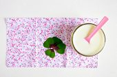 pic of buttermilk  - Fresh buttermilk in a glass and clover plant - JPG