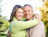 image of elderly couple  - Happy elderly seniors couple in park - JPG